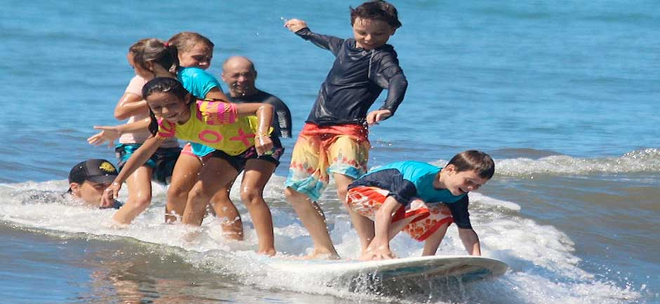 kids playing on a surf board